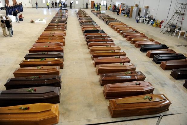 Le bare dei migranti morti nel naufragio di Lampedusa dell'ottobre 2013 (Ansa)