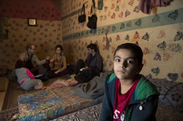 Famiglia siriana in un campo profughi libanese