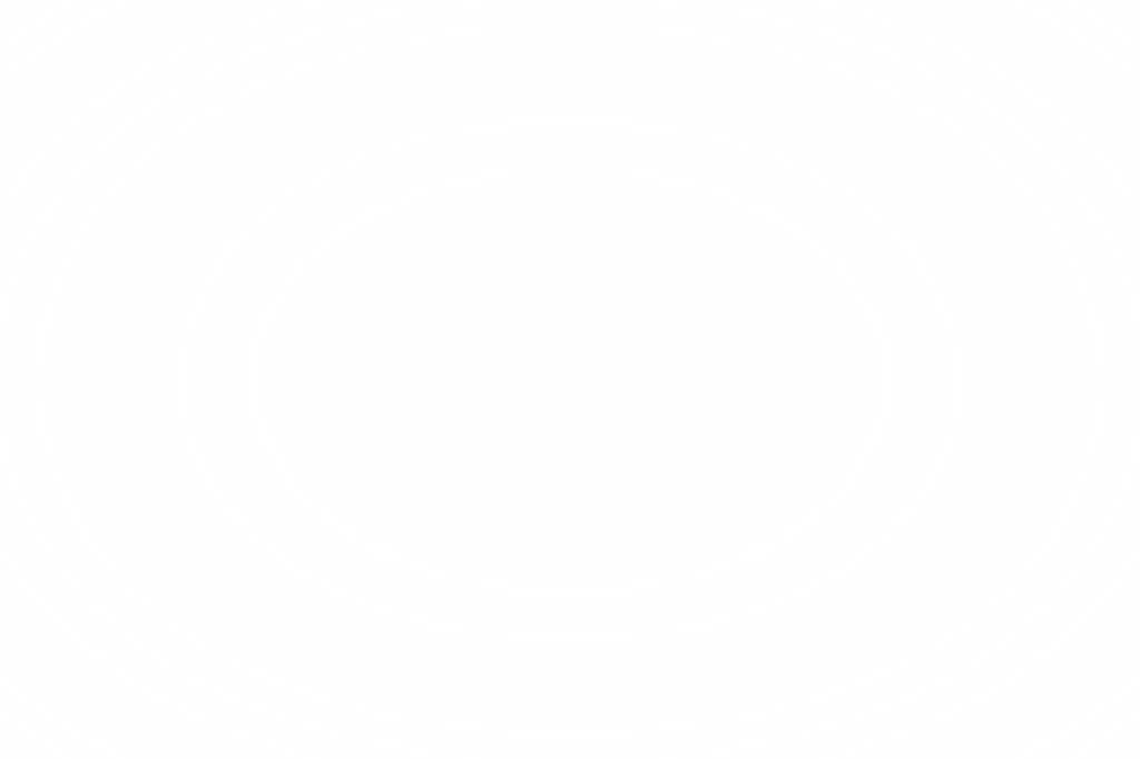 Un agente davanti alla casa perquisita (LaPresse)