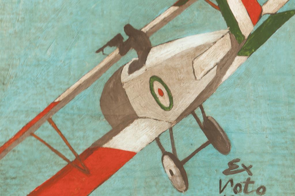 """Anonimo """"Ex-Voto 1918"""", olio su cartoncino. Bella immagine di un caccia della Prima Guerra Mondiale. Si tratta di un Nieuport 11 (Bebè) o un Nieuport 17, aerei francesi con cui furono equipaggiate diverse squadriglie italiane (Fondazione PGR) -"""